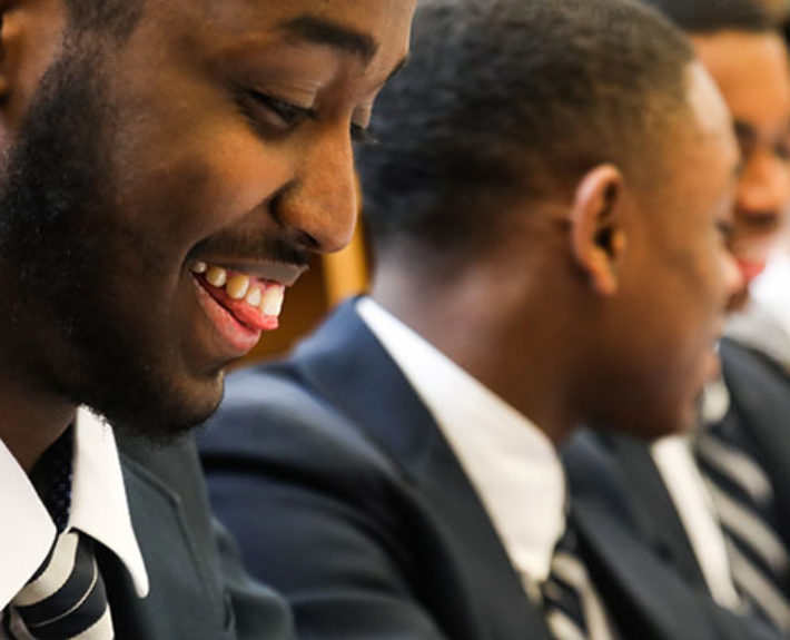 Students from Barack Obama Male Leadership Academy find out that they have received TCU's Community Scholars scholarship. Photo by Amy Peterson, March 19, 2018